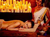 stock photo of panchakarma  - Young woman having oil Ayurveda spa treatment - JPG
