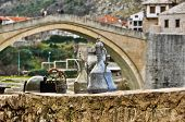 foto of old bridge  - Traditional Souvenirs with Old Bridge in Background in Mostar - JPG