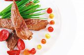 picture of chive  - hot fresh grilled red beef meat fillet with vegetables  green chives and peppers on china plate isolated over white background - JPG