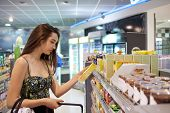 picture of supermarket  - Young couple shopping in a supermarket - JPG