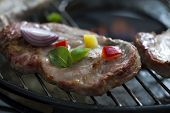 picture of braai  - Close up of some steak on grill with vegetables - JPG