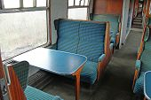 foto of passenger train  - Seating on a Vintage Railway Train Passenger Carriage - JPG