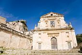 stock photo of mary  - The facade of the baroque church of Saint Mary of Consolation in the town of Scicli in southern Sicily in Italy - JPG