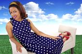 foto of surrealism  - black female in a vintage polka dot dress in a surreal outdoors setting - JPG
