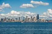 pic of puffy  - White puffy clouds hover over the Seattle skyline on a sunny day - JPG