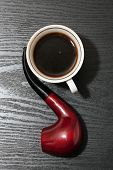 foto of tobacco-pipe  - Cup of coffee and a tobacco pipe on a wooden table - JPG