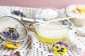 image of candy  - Making candied violet flowers with egg whites and sugar - JPG