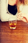 stock photo of alcohol abuse  - Yound beautiful woman in depression - JPG