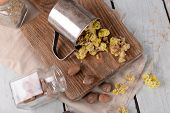 foto of roughage  - Dried herbs with nutmeg on table close up - JPG