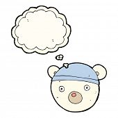 foto of bear cub  - cartoon polar bear cub wearing hat with thought bubble - JPG