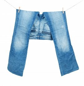 stock photo of peg-leg  - Blue Jeans On Washing Line Isolated On White  - JPG
