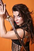 foto of gruesome  - woman with sword and scabbard over her shoulder - JPG