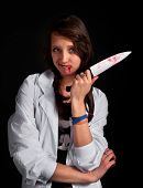 Angry Nurse With Bloody Knife Over Black
