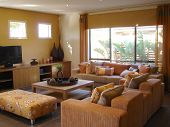 picture of lounge room  - Warm living room with comfortable couches and TV - JPG