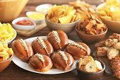 Tasty snacks prepared for super bowl party, close up view poster