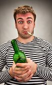 image of sobriety  - Drunk bizarre sailor with bottle and cigarette - JPG