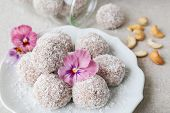 Homemade Strawberry, Date, Cashew And Coconut Bliss Ball With Edible Flowers poster