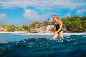 Attractive Surf Girl On Surfboard. Woman In Ocean During Surfing. Surfer And Ocean poster