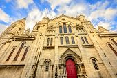 Left Side Facade And Door Of Basilique Sacred Heart In Montmartre Of Paris In France With No People. poster