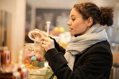 Young woman shopping in a candy store.