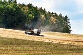 The Harvester Harvested Grain In The Czech Republic. Agricultural Machinery. Summer Farm Work poster