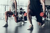Close Up. Man And Woman Training In Fitness Club. Man With Athletic Body. Healthy Lifestyle And Spor poster