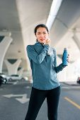 Runner Wiping Out Sweat After Workout Outside poster