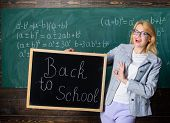 Beginning Of New School Season. Woman Teacher Holds Blackboard Inscription Back To School. Are You R poster