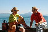 picture of elderly couple  - romantic elderly couple enjoying retirement by the lakeside - JPG