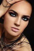 Young beautiful tanned woman with smoky eyes
