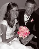 stock photo of wedding arch  - BW Photo with Pink of bride and groom at a stylish wedding - JPG