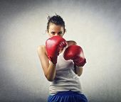 stock photo of pugilistic  - young woman boxer - JPG