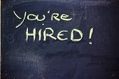 You're Hired Message On Chalkboard