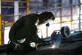 Worker Using A Welding Torch