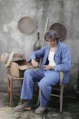 picture of machete  - man in a retro interior sharpening a machete - JPG