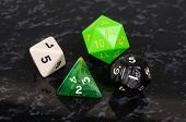 picture of octahedron  - Platonic dice selection against a black background - JPG