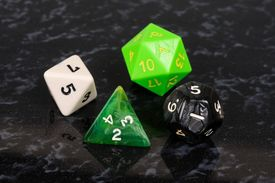 image of dodecahedron  - Platonic dice selection against a black background - JPG