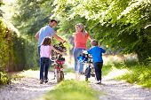 picture of 8-track  - Family Pushing Bikes Along Country Track - JPG