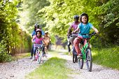 stock photo of granddaughters  - Multi Generation African American Family On Cycle Ride - JPG