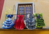 stock photo of traditional dress  - Traditional flamenco dresses at a house in Malaga Andalusia Spain - JPG