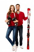 picture of ski boots  - Two young people stand with skiing and ski boots - JPG