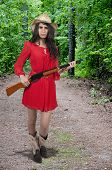 pic of redneck  - Beautiful young country girl woman wearing a stylish cowboy hat shooting a rifle - JPG