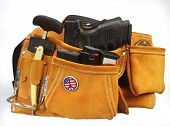 stock photo of mayhem  - Suede tool pouch filled with weapons - JPG