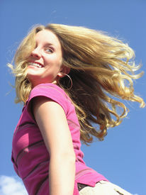 picture of titillation  - teen with hair flying and a fun look - JPG