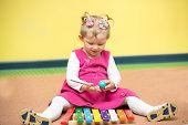 image of montessori school  - Little child girl playing in kindergarten in Montessori preschool Class - JPG