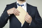 picture of bribery  - young businessman in a suit - JPG