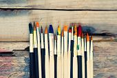 foto of bristle brush  - Photo of paint brushes on wooden background - JPG