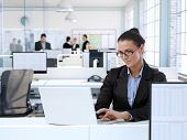stock photo of trustworthiness  - Trustworthy businesswoman working at office desk - JPG