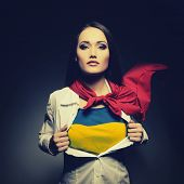picture of independent woman  - Young woman opening shirt painted in colors of ukrainian flag like superhero - JPG