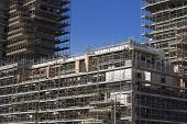 image of scaffold  - Scaffolding on a construction site of a new building - JPG